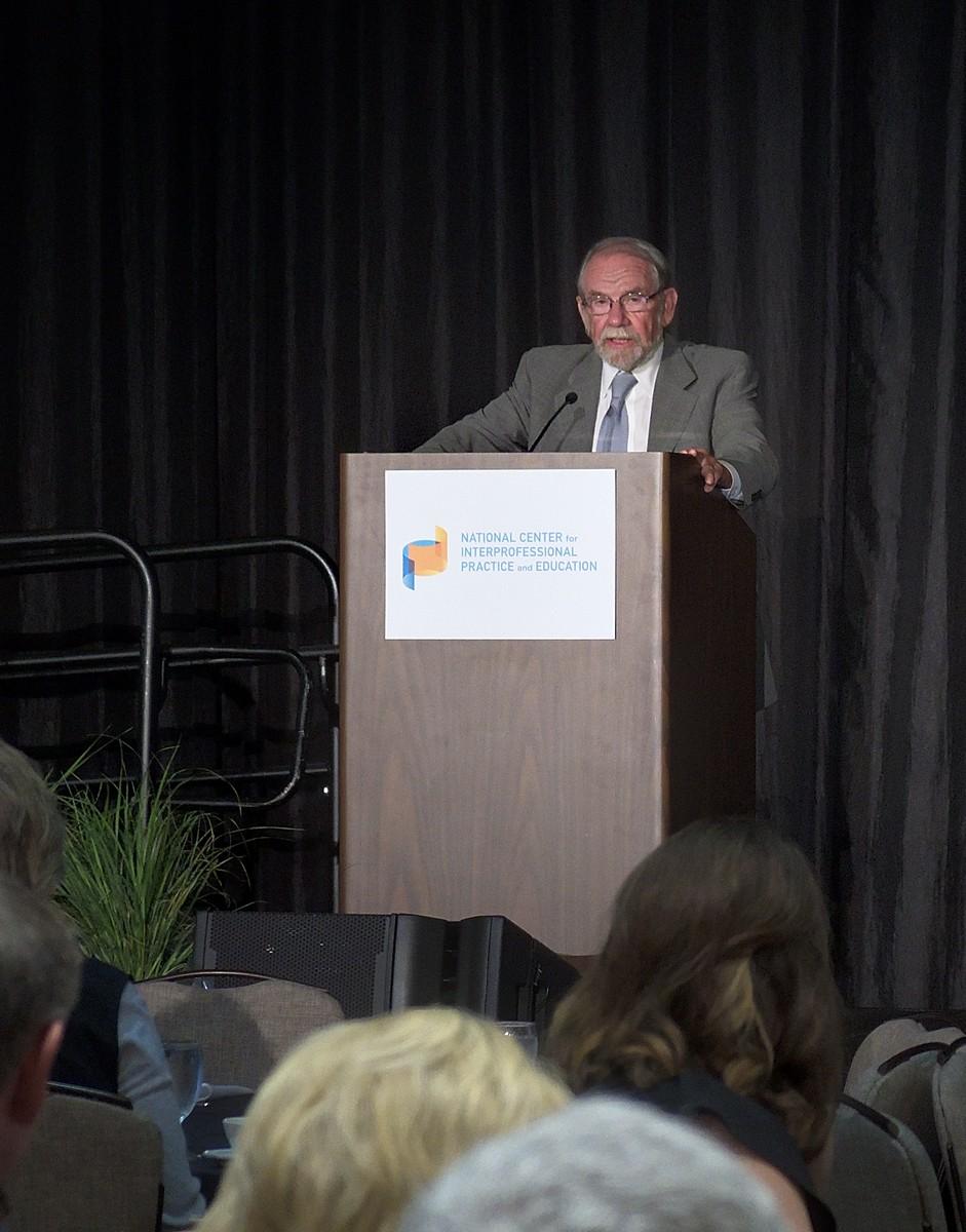 George Thibault at podium